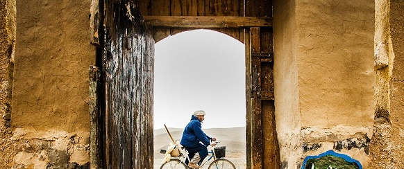 """National Geographic photo of the day: 19th May"" National Geographic's photo of the day: 19th May National Geographic's photo of the day: 19th May man bike morocco door 79793 990x7421"